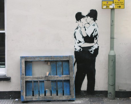 Kissing Coppers banksy 439797 854 680 460x366 Banksys Kissing Coppers to be sold and shipped to America